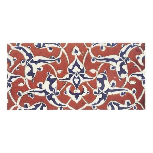 Postcard Border tile with blue and white arabesques on a red ground